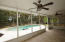 Wonderful Screened Porch on Back of House looking out to Inground Pool