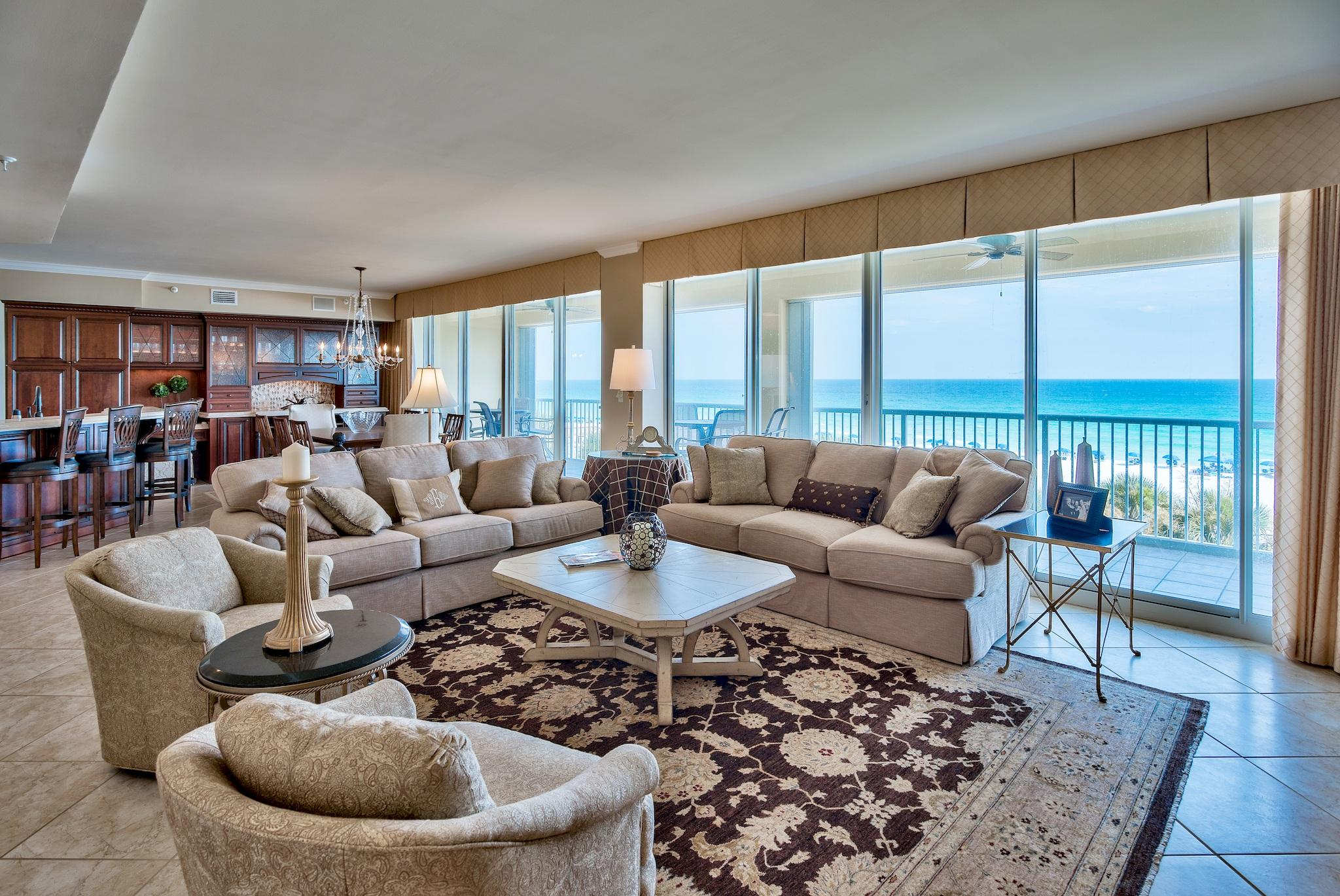 Phenomenal fully renovated custom unit at Oceania with a 60 foot wide balcony that looks right out onto the pristine beaches and emerald green waters of the Gulf of Mexico. This unit it just under 2,000 square feet and has floor to ceiling glass windows & doors that span across the entire front of the unit bringing the outside in. The views are truly breathtaking, not to mention the sophisticated and elegant interior. This unit has never been a rental unit and is impeccably maintained. Interior has been fully updated (~$260k) with beautiful custom wood cabinets, marble countertops, new kitchen appliances, updated fixtures, sinks/tubs, lighting & flooring. All bedrooms offer en-suite bathrooms and are generous in size. The unit is being sold fully furnished & decorated and is sure impress! The floor plan is incredible with an open living & dining area capturing beautiful views of the Gulf, crown molding and raised ceilings. There are remote controlled blinds along with plantation shutters in some of the bedrooms. Porcelain floors extend throughout the main living & dining areas and master bedroom - great for beach living! The guest bedrooms has new upscale carpet. The kitchen has also been fully renovated and is exquisite. The rich hardwood cabinets have a delicate trim and set the tone for the kitchen. The custom cabinets and glass extend to the wet bar area along with stunning marble countertops and a beautiful tiled backsplash. There is a formal dining area with Gulf views and a breakfast bar for more casual dining. The dining and living area opens up to the massive 60 foot balcony, which is the perfect place to unwind, enjoy the sunset or entertain.   The master suite is on the west wing of the unit and is a great sized room with a seating area, direct balcony access, walk-in closet and impressive en-suite master bathroom. The bathroom has marble countertops, double vanity, custom cabinets, Jacuzzi tub and separate walk-in shower. A wall was opened up to create a larger shower area. There are two guest bedrooms, each with en-suite bathrooms, a laundry area and plenty of storage. There is a storage unit right outside the unit and a larger one on the 3rd floor off the elevator. You don't have to bring in your sandy beach gear into the condo. There is also an assigned parking space for the unit, which is a nice convenience.   Oceania is located right on the beach on legendary Holiday Isle in the heart of Destin. The community is gated and features a gulf side pool and exercise room. The lobby & poolside owner's lounge was recently renovated for a contemporary look. Relax in the sand, at the pool, or enjoy the stunning views from your balcony. Located on Holilday Ilse in the heart of Destin, you are just minutes from all the dining, shopping and entertainment you could ask for in your new beachfront retreat.