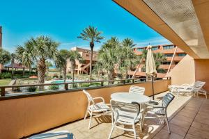 Relax on the coast! The spacious balcony overlooks a gorgeous tropical courtyard with a pool and gazebo. The emerald water of the Gulf of Mexico glistens in the sun as you enjoy your own oasis in paradise!