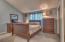 Vaulted ceilings in spacious master bedroom