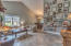 Vaulted ceilings and 18 inch tile throughout living room