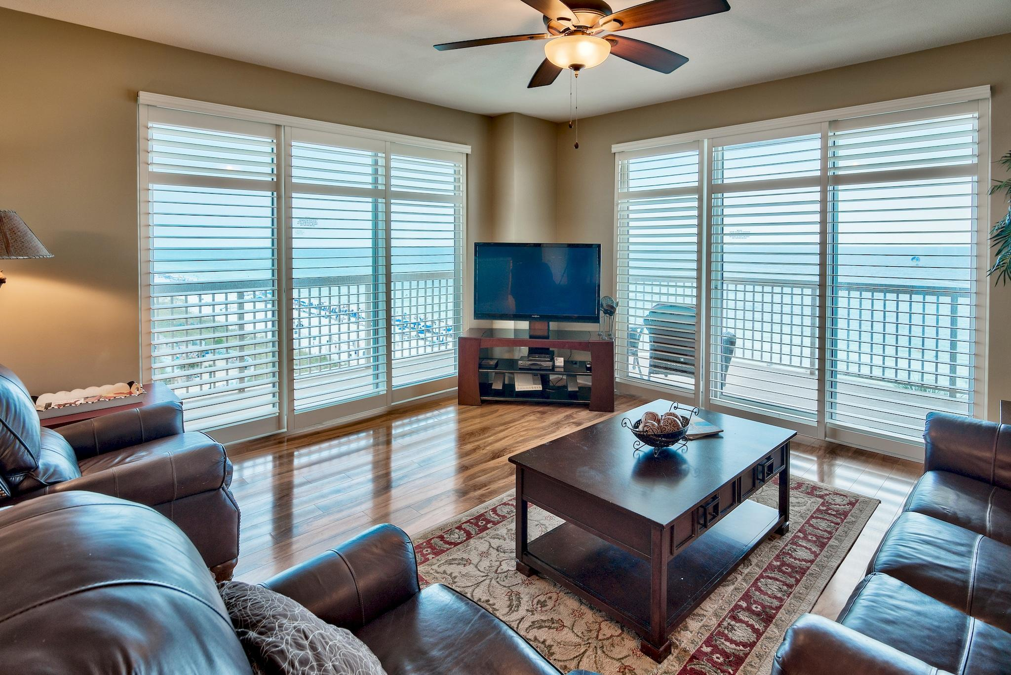Phenomenal opportunity to own a 3-bedroom, 3-bath East end corner unit! The corner units rarely come on the market and this will not last long. Large windows & doors surround the unit bringing in great natural light and stunning views of the Gulf of Mexico. The spacious wraparound balcony is accessed from the living area or master bedroom and is the perfect place to relax, entertain or enjoy outdoor dining. Enjoy views of the Gulf of Mexico, shimmering white sand beaches and the expansive pool area. Exquisite details and features abound in this breathtaking unit. Interior details include an open floor plan, custom plantation shutters throughout, beautiful wood floors and stylish decor. This luxury unit is being sold fully furnished & decorated and is a prime turn key investment! There is a great formal dining area with views of the Gulf and an open kitchen with granite countertops, tile floors, and ample cabinets. The granite breakfast bar is perfect for casual dining. The Gulf front master bedroom is separate from the other two bedrooms for added privacy. The room is very spacious with direct baloney access, custom plantation shutters, walk-in closet and en-sutie bathroom. Enjoy your morning cup of coffee on the balcony while taking in the views. The en-suite bathroom offers tile floors, double vanity, soaking tub to unwind in and a separate walk-in shower. There are two guest bedrooms - one with Gulf views and an en-suite bathroom and the additional guest bedroom has a separate bath nearby. There is a laundry room with a full size washer & dryer and storage. This unit is currently a non-rental and well maintained, however, this could easily be an income producing rental unit - projected at nearly $49,000!  Sunrise Beach has luxurious amenities including: 2 elevated Gulf front pools, one heated seasonally, 2 spas, large sun deck, spray park, owners lounge with full kitchen, Gulf front exercise room, theatre, plenty of underground parking, Gulf front gas grills, 330