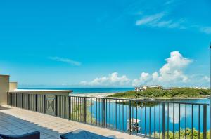 Enjoy Stunning View of the Gulf of Mexico and Big Red Fish Lake from the top Balcony of this Sanctuary by the Sea Residence.