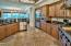 Chiefs Kitchen with recess lighting, tiled flooring, custom cabinets, granite counter tops and Viking Professional appliances.