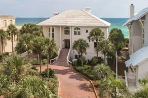 This remarkable luxury home is beachfront in the exclusive 30-A area