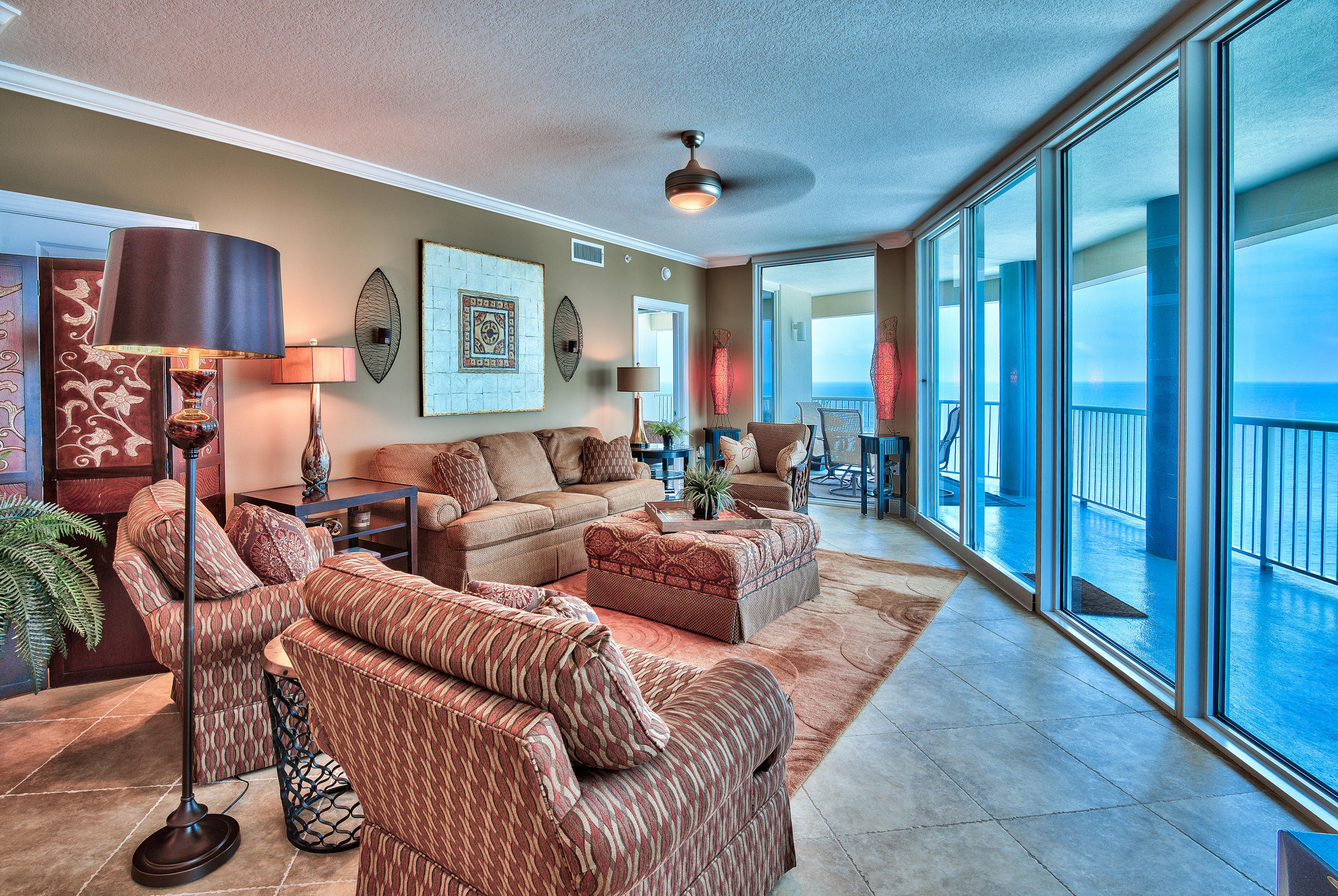 Unique luxury condo offering features that are unmatched along the Emerald Coast! Unit #508 is easily the most exquisite unit at Palazzo and is a breathtaking 3BR/3BA furnished West end corner unit. Unit is being sold fully furnished and decorated with two balconies and storage locker P4-03. Enjoy panoramic views of the sugar white sandy beaches and Emerald waters of the Gulf of Mexico. Let the sunshine in! Floor to ceiling glass throughout the unit maximizes the spectacular views and the glass has additional tinting to block UV rays keeping the unit cooler on summer days. Sunsets are stunning from either of your two private Gulf front balconies, totaling 415 sq. ft. The spacious, open floor plan features raised 9' ceilings and 20'' diagonal tile floors throughout. Kitchen features thick solid granite countertops and breakfast bar, custom stone tile work on the backsplash above the kitchen countertops and below the island bar, recessed lighting, upgraded wood cabinets, and stainless steel appliances. The spacious master bedroom has stunning views of the Gulf of Mexico by the surrounding floor to ceiling windows. There is a large walk-in closet and an on-suite master bathroom with double vanity, Whirlpool tub, and separate walk-in shower. The master bathroom has been upgraded with new granite countertops and is especially unique with the custom tiled shower. The guest bedroom also has an upgraded on-suite bathroom and separate, private balcony facing West. A private guest balcony is very rare for condos in the area, so this is definitely a special feature of the unit. There is an additional guest bedroom and bath that is stunning as well. This unit sleeps 8+ guests and has a full size washer/dryer closet with storage. This unit is in pristine condition.   Palazzo amenities include elevated Gulf side pool, hot tub, complimentary beach service (Mar-Oct), fitness facility, and meeting room. At Palazzo you are on the desirable West End of Panama City Beach, 1 mile from Pier Park shopping center, and less than 20 minutes from the Panama City Beach International Airport. Unlike the competition, Palazzo is a low density building consisting of only 129 direct Gulf Front units and has four levels of covered Gulf Front parking under the building - no need for massive parking garages with elevated walkways across the street. Do not miss out on this incredible opportunity to own an upgraded corner unit at one of the finest condominiums in Panama City Beach! Unit #508 truly is the perfect second home, full time residence, or vacation rental.