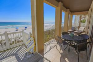 Main level veranda invites relaxing or dining with the best view imaginable.