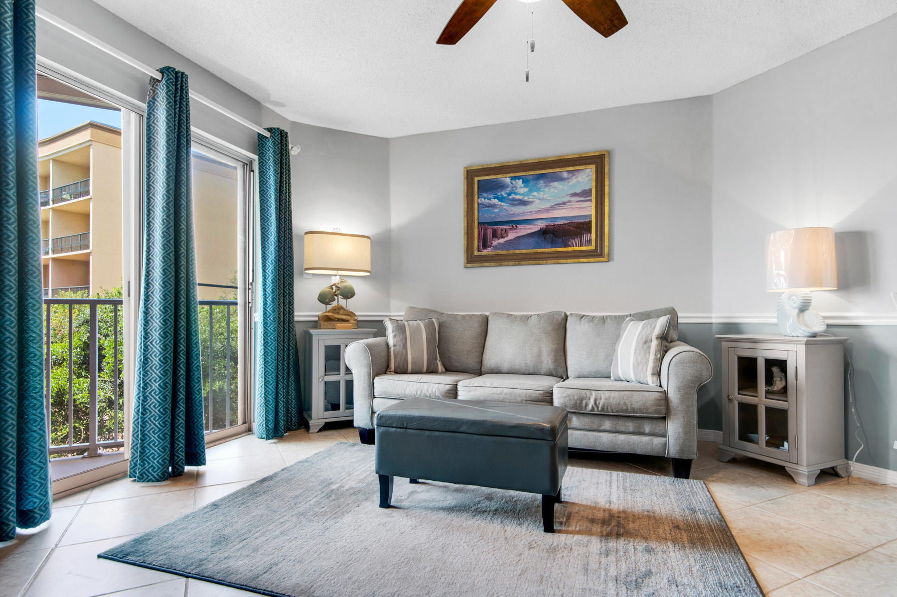 This condo in Gulfview II, conveniently located in the heart of Miramar Beach, opens up a world of vacations or rental income potential.  With deeded beach access directly across Scenic Gulf Drive to over 100 feet of beautiful beach, two community pools, hot tub and a grill area, owners and guests can enjoy the quintessential Florida lifestyle. Located in a low-density building, this one bedroom condo has been updated to include tile flooring throughout as well as a stylish kitchen that features modern raised panel cabinets and stainless steel appliances.  The condo also features built-in bunk beds in the hallway. The living area features a large sliding glass door which allows for ample natural light and opens to the private balcony - The perfect place to relax after a day at the beach.
