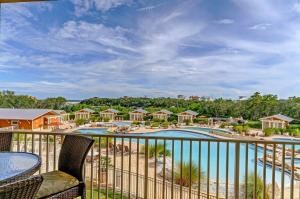 What a great view, not only of the pool, but the coastal dune lake and natural setting.