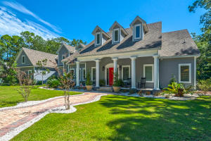 Beautifully landscaped front view of 168 Woodland Bayou Drive