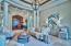 Solid mahogany doors open to formal sitting room