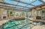 Beautiful pool, spa, and outdoor entertaining area overlooking the lake