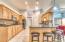 Mosaic Backsplash, double oven and oversized Pantry