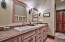 Bathroom with double custom built vanity, shower/tub combo, large closet