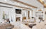 Living Area - gas fireplace, wide plank exposed beams, custom built-ins and wet bar.