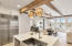 Exposed beams throughout the first floor with open living area and kitchen.