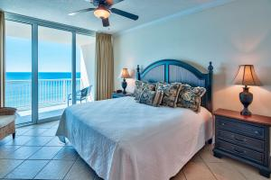 The gulf front master features a king size bed, tile floor, crown molding, and floor to ceiling glass sliders that let you easily slip outside onto the private balcony overlooking the beach.
