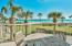 The second floor terrace overlooks beautifully landscaped grounds, the beach, and the Gulf of Mexico.