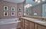 The master bath has a large dual vanity, granite counter, whirlpool tub and a tray ceiling.