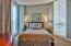 2nd floor bedroom with plantation shutters and a private balcony shared with another bedroom.