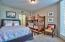 This ground floor bedroom features a full size bed and a bunk bed for extra sleeping accommodations.