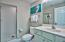 This contemporary ensuite bathroom has a large tiled walk-in shower.