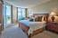 The ground floor, gulf front master bedroom is big, bright, and furnished with a king size bed.