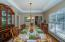 Dining Room off the Foyer and Kitchen with tray ceiling and bay window.