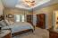 Master Suite w/tray ceiling, french doors to covered porch, and 8x6 walk-in-closet