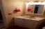 Main Floor Half Bath with Updated Vanity, Sink, Plumbing Fixtures, Lighting, and Mirror