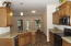 Fantastic Kitchen with granite counters, stainless steel/black appliances, Dishwasher, smooth top cook stove, custom cabinets, wood looking tile flooring & built-in microwave.