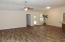 Spacious great room with wood looking tile in all wet areas.