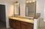 dual vanity & granite counters in master bath.