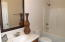 2nd bath with tub/shower combo with linen closet behind door.