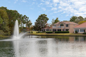 Home sits on lake with fountain and has both lake and golf course views.