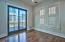 French doors open to the beautiful deck