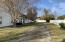 Huge lot. 80' wide. Garage parking in back. Room for additional structure at the end of this drive.