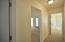 Hallway off Family room with the two additional bedrooms and bathroom