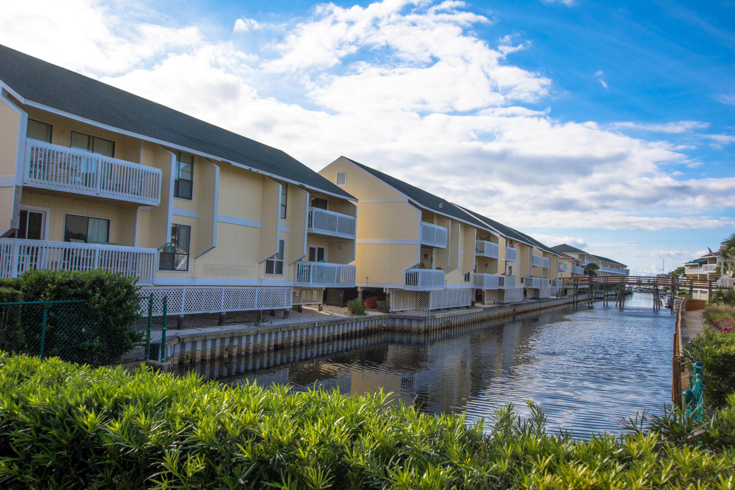 This lovely canal front condo has everything you need to start enjoying the fabulous beach lifestyle. Great view of the canal from your private balcony and just a short stroll to the beach. Many great amenities including marina, 5 pools, 3 hot tubs, 6 tennis courts, a Par 3 executive 9 hole golf course and  2 onsite restaurants. This popular resort is located near many great attractions. Plenty of room for the whole family, you can also do vacation rentals to capture high dollar summer rental income. Buyer to verify all information.