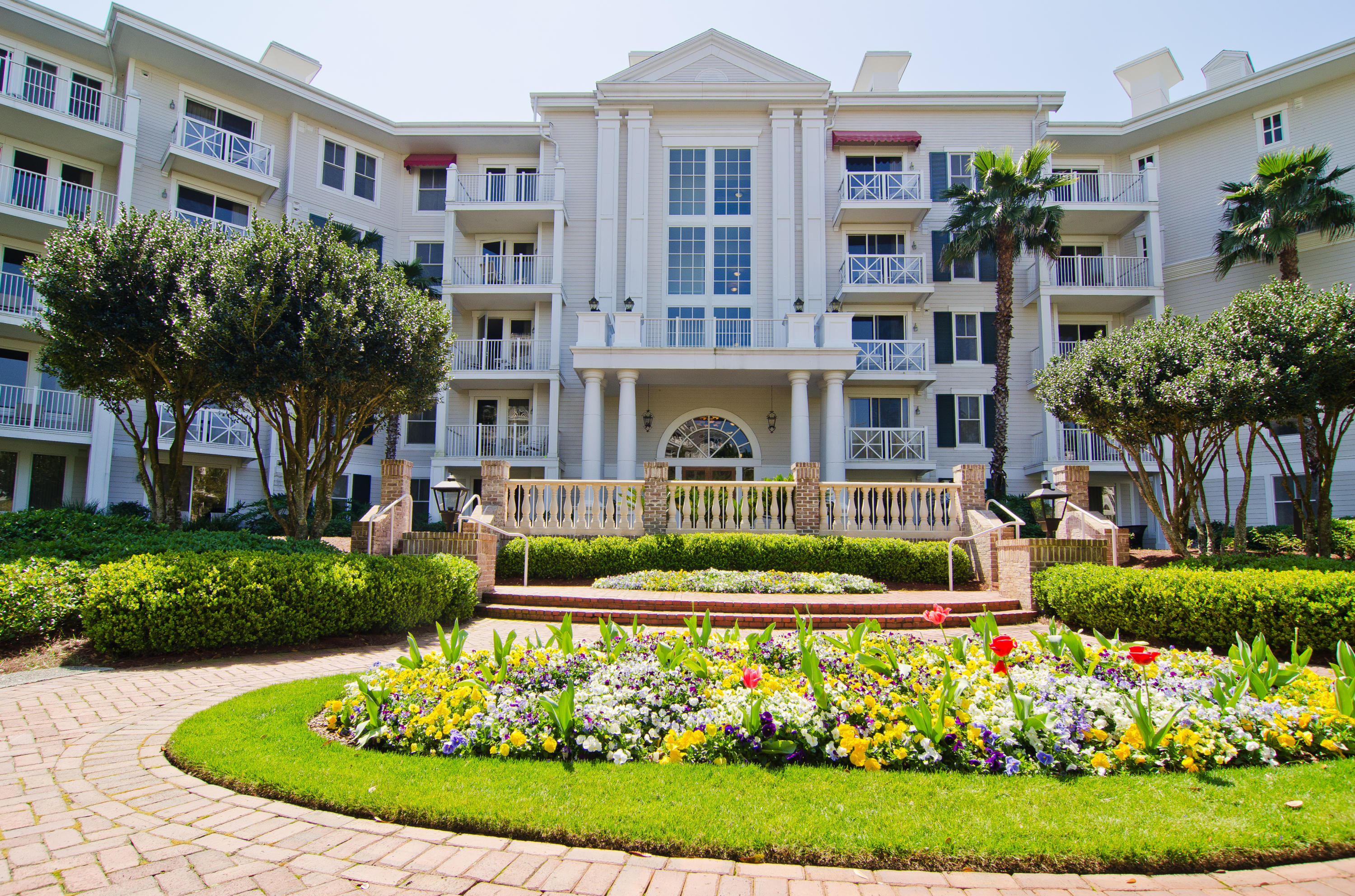 """One of the largest 1bed/2bath floor plans with a balcony in Lasata. Located on the 2nd floor with views of the Grand Gardens. This resort home has been updated with beautiful hardwood style tiled flooring throughout the living area and bedroom, flat screen TV's, and new bedding. ''A'' rated on the Sandestin Rental Program. Guest and owners will be able to take advantage of a private gift shop, fitness center, and resort style pool. Conveniently located near the Village of Baytowne Wharf which is full of daily and nightly activities, restaurants, and shopping. As an introduction to the Sandestin lifestyle, we invite our new owners to explore amenities that make Sandestin special. The listing brokerage and seller(s) are presenting the buyer(s) of this property with (2) 90-minute rounds of Tennis court time, a golf foursome at one of our three championship courses, a round of golf for up to four (4) players and an invitation to """"Club Night"""" at the unrivaled Burnt Pine Golf Club.  Sandestin Golf and Beach Resort is a major destination for all seasons and all ages, and has been named the #1 resort on Florida's Emerald Coast. This magical resort spanning over 2,000 acres is comprised of over 70 unique neighborhoods of condominiums, villas, town homes, and estates. The resort features miles of sandy white beaches and pristine bay front, four championship golf courses, a world-class tennis center with 15 courts, 4 resort swimming pools (and 15 private neighborhood pools), a 113-slip marina, a fully equipped and professionally staffed fitness center and spa, meeting spaces and The Village of Baytowne Wharf, a charming pedestrian village with events, shopping, dining, family entertainment and nightlife. For true golf cart community living, Grand Boulevard is just outside the resort gates and provides access to additional shopping, dining and entertainment â"""" all without traveling on Hwy. 98.  Come to Play, Stay for Life!"""