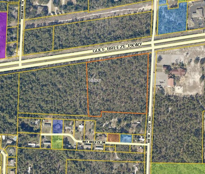 7.788 Commercial Acres, corner location in Gulfbreeze at the corner of New Hope Road and Hwy 98, adjacent parcel is listed for sale also, great development parcel