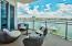 Expansive private balcony overlooking the Destin Harbor. Views are maximized with the unique glass railings (1 of only 9 units have this).