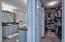 The large walk-in offers plentiful closet space along with shelving.