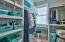 The giant walk-in closet offers plentiful wardrobe and storage space.