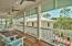 The master suite balcony features recessed lighting, custom ceiling fans, Cumaru deck and tongue and groove wood ceilings. The balcony overlooks the pool deck, and the forest beyond makes this your own private oasis on the coast.