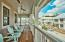 The spacious balcony is perfect for experiencing the Florida coastal lifestyle.