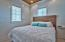 Bedroom with en-suite bath. You will find all the custom features here as in the main house, with Ash flooring, shiplap walls, tongue and groove ceilings and recessed lighting.