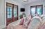 Additional bedroom on first floor with private bathroom & access to patio facing the gulf.