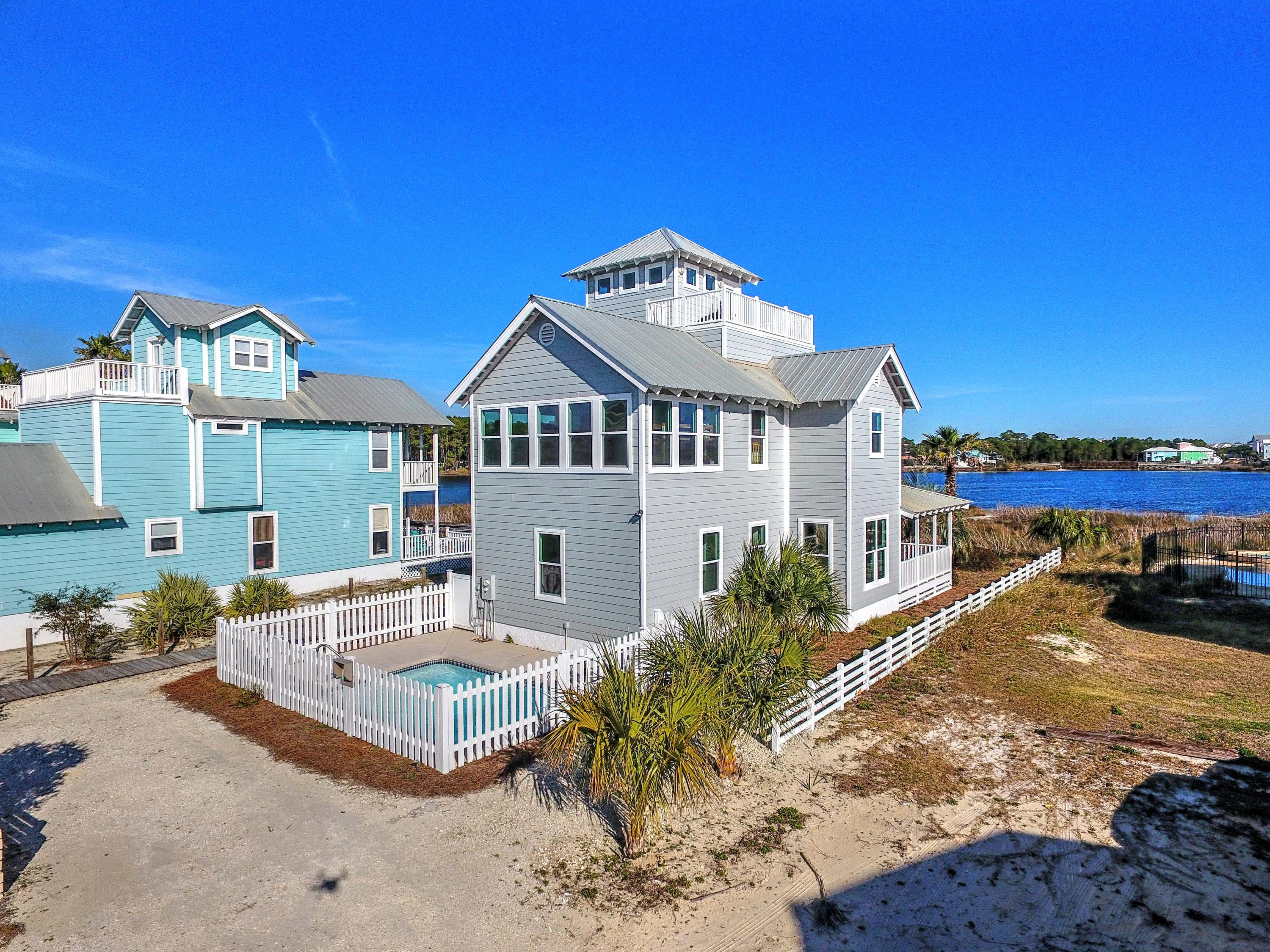 Picturesque vistas abound from this fully furnished, four-bedroom, three-bathroom, coastal masterpiece featuring unobstructed views of the Gulf of Mexico and over 50 feet of waterfront on world-renowned Oyster Lake.  Located just steps from the stunning white sand beaches & dunes of the Gulf of Mexico, this luxuriously designed 2,016 square foot Dune Allen home has finally been exposed to the market and artfully combines coastal design with classic architecture indicative of quintessential Dune Allen and its beautiful, pristine surroundings. Positioned at the southernmost point of Oyster Lake and boasting over one-third of an acre, 21 Sugar Beach Drive is perched at one of the highest elevations in Dune Allen with private access and no through traffic, and no HOA. The architectural detailing of this home serves as a canvas for extraordinary views of two of Florida's most coveted waterways, Oyster Lake, and Dune Allen beach on the Gulf of Mexico, and the community's hallmark dock which is shared with two historical Dune Allen homes. Notable features include abundant natural lighting and water views from every level of the home, hurricane resistant doors and windows, two brand new HVAC systems, brand new pool pump, brand new fence, and fresh paint on the interior and exterior, hard wood floors in the main living areas, tile in the bathrooms, granite counter tops in the kitchen, a handmade custom backsplash in the kitchen, and a gourmet kitchen with spacious countertops and cabinets.  Every day features a view toward shimmering Oyster Lake and magnificent sunrises, afternoon dips in your private pool, and evenings watching 30a sunsets from your 3rd floor watchtower. In addition, the first floor features an oversized living and dining room. There is also an in-law suite and full bath on the main level off the kitchen. On the 2nd floor, there is a master bedroom with panoramic views of the Gulf and Oyster Lake. There is another guest suite, a separate bunkroom and a full