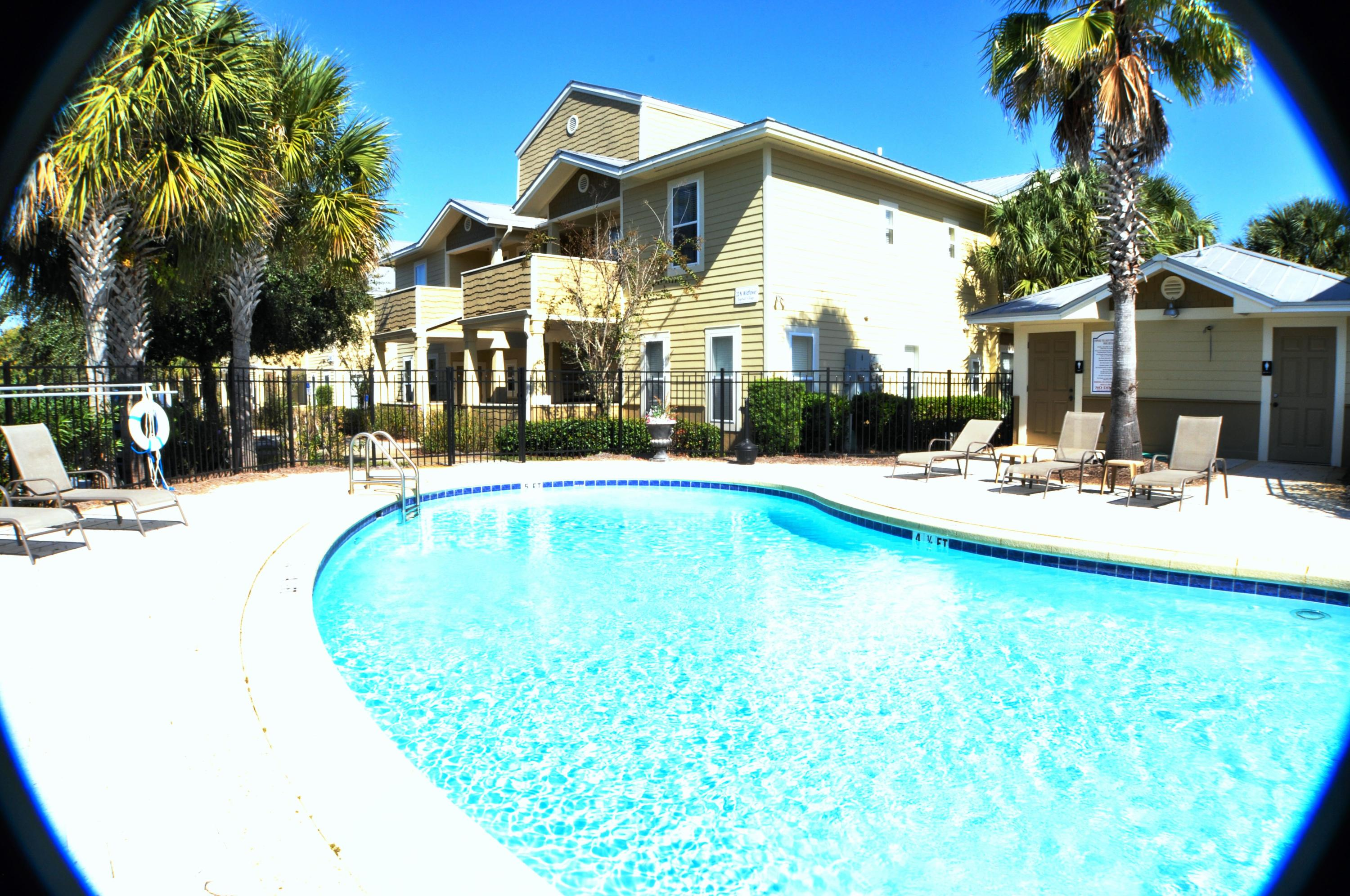 **New AC Unit put in this week 6/12/2019 with 10 yr Warranty** 2 BR 2 BA Condo -- second floor --facing the back. Unfurnished. All the appliances and washer and dryer are included.  Kitchen features black granite, real wood cabinets, black appliances, and tan tile. Both bedrooms have light walls and carpet. TopSail Village is near the new Sacred Heart Hospital, Walmart, Publix, Restaurants, and shopping. Beach access is less than a mile away. Pets under 40lbs are allowed.